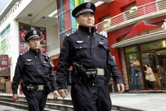 This picture shows current day Shanghai police. This will be similar to what Officer Baylen wears when he appears in Act II, to investigate the real-estates robbery. He is not dressed in ancient clothing, as he is part of the outside modern-day Chinese society.