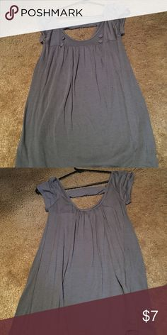 One clothing medium grey shirt Short sleeve, grey top, v neck, with decorative buttons on front, back is cut out and has one cute decorative strap one clothing Tops