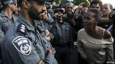 Israel police clash with Ethiopian Jewish protesters A protester, who is an Israeli Jews of Ethiopian origin, shouts at a policeman during a demonstration in Tel Aviv May 3, 2015.