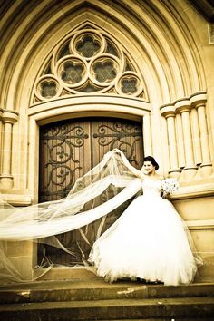 Anna on the steps of St Mary's Cathedral Sydney - wedding photo by PM PHoto