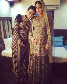 Karishma kapoor in black saree and Kareena Kapoor in green lehanga by Sabyasachi at Lakme Fashion Week 2016