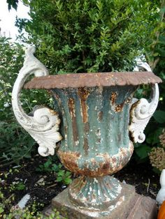 Antique pair cast iron urn