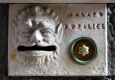 Post box and doorbell with face sculpted in stone. Venice, Italy 2009