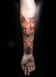 Sketch work style fox and rose tattoo on the right inner forearm.