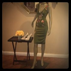 Mandalay Emerald Green Cocktail Dress Beautiful emerald green cocktail dress. Silky material with embroidered flowers perfectly placed throughout the dress. Fits tight and is super flattering on curves. New and never worn, with tags. Shoes, bags and necklace is not included. Mandalay Dresses