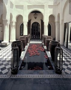 Love the rose petals sprinkled on this courtyard pool. Open courtyard somewhere in Marrakesh.