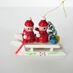 Vintage Wooden Sled Ornament, Santa Claus & Friend on Top, Bottle Brush Tree and Gifts Wooden Ornaments, Angel Ornaments, Vintage Ornaments, Christmas Ornaments, Bottle Brush Trees, Make An Effort, Green Accents, Sled, Recycled Materials