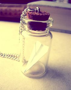 This cute necklace was made from little glass bottle with vintage style tiny…                                                                                                                                                                                 Mais
