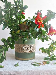 A can repurposed into a vase, How to Repurpose cans instead of being overrun by them / theboondocksblog.com