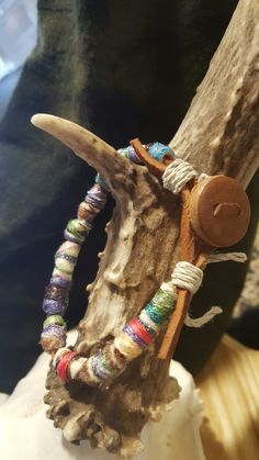 Hand made wool beads with antique leather button bracelet