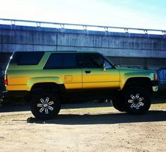 """My 1985 Toy Hilux 4Runner. Lexus Quad-Cam V8 conversion (1UZ-fe for those playing at home), soon-to-be R151 box, custom centres, breathers (...pretty much custom everything), rear air bags w/ tow package, cloth interior, soon to be mix of leather, vinyl, marine carpet with some cloth remaining. 4"""" body lift. 33"""" shoes. And who could forget that glorious Harlequin Gold? #toyota #hilux #4runner #surf #lexus #v8 #quadcam #truck #beast #unique #4x4 #braaaarp"""