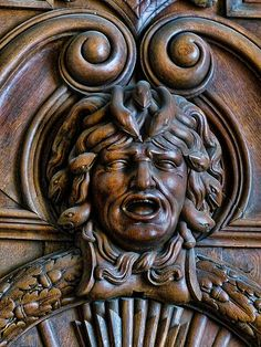 Medusa carved on ornate wood door in Francois I Gallery at Fontainebleau