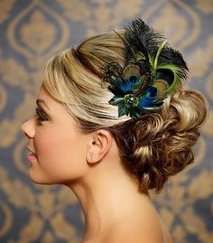 The Bridget fascinator is a beautiful combination of goose feathers in shades of green with brilliant peacock feathers accented with a pretty jewel