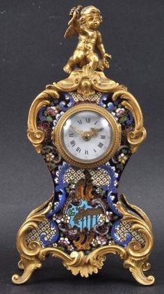 Lot: A 19TH CENTURY FRENCH ORMOLU AND CHAMPLEVE ENAMEL MANTL, Lot Number: 1354, Starting Bid: £600, Auctioneer: John Nicholson Auctioneers, Auction: FINE ANTIQUES AND COLLECTABLES, Date: May 22nd, 2013 WEST