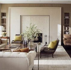 Great Room, I love this idea.  Traditional upholstery in neutrals and Holly Hunt chairs on pedestals