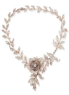 AN ANTIQUE DIAMOND NECKLACE, CIRCA 1860. Composed of an articulated series of rose and old European-cut diamond foliate links, enhanced at the front by a similarly-set flowerhead, extending rose and old European-cut diamond leaves and tendrils, mounted in silver and gold, (central panel may be worn as a brooch, with brooch fitting, leaf links detach). #antique #necklace