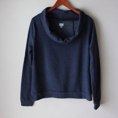 "Converse One Star sweatshirt Dark blue sweatshirt - cowl neckline - long sleeves - ribbed trim - size slits at hemline - cotton/polyester combo - great condition and soft - chest across measures 20"" - total length measures 24"" - size XL Converse Tops"