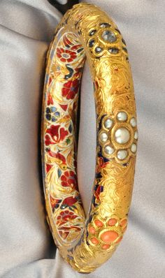 Gold and Enamel Gem-set Bangle, India, set with various foil-back cabochons, the interior with fine floral and foliate polychrome enamel, interior cir. India Jewelry, Ethnic Jewelry, Antique Jewelry, Gold Jewelry, Jewelery, Jewelry Accessories, Jewelry Design, Fine Jewelry, Gold Bangles