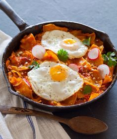 """As a Mexican this is my favorite breakfast, """"Chilaquiles"""" (tortillas cut into pieces fried with eggs, red/green salsa, cheese) with a side of refried beans.%%% not so healthy"""