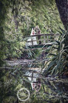 Bride and groom on bridge at Trentham park, upper Hutt. New Zealand #wedding #photography. PaulMichaels of Wellington http://www.paulmichaels.co.nz/