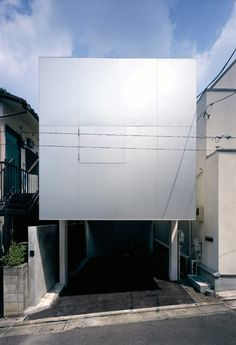 Long Tall House is a residential project in Tokyo, Japan, by Kagawa Takanori and Tappei Ito of Spacespace. The five-storey house occupies a narrow plot and comprises a long building and a tall tower. The two basement floors are built in concrete, while the three upper stories are made of timber. Large, aluminium panels on