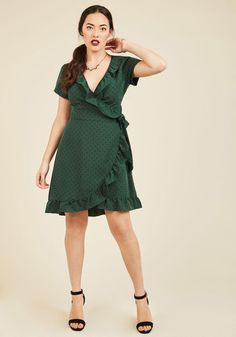 Busy and beautiful can coexist with this ModCloth-exclusive wrap dress on hand! Twirl into this tied piece's forest green hue and fun black polka dots, welcoming its gathered back accent and ruffled edges to bring a fun flirtatiousness to all your to-dos.