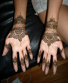 Pretty fishnet-style design henna / mehndi inner wrist and fingers