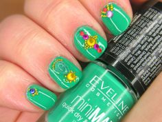 Very bold, Bollywood inspired nail art - lots of stones, caviar, beads etc.
