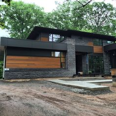 #CustomeHome with a mix of natural #Stone #Stucco and #Maibec natural #Wood elements #Exterior #Design #Concept #Toronto #Contractor #Builders #Construction