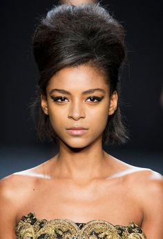Trendy hair for FW 2015: 1960′s Bouffant Hairstyle. Volume beehive + side swept bang + loose back hair at Badgley Mischkafall winter 2015.
