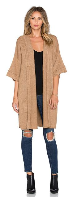 Cozy hood poncho by SOH. 55% baby camel 45% nylon. Dry clean only. Open front. Hooded. Side welt pockets. SOHR-WK4. 2241. ...