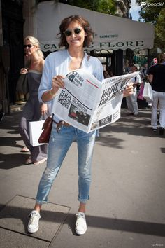Inès de La Fressange reading Haute Off the Press. Paris, 20 September, 2014. Inès Marie Lætitia Églantine Isabelle de Seignard de La Fressange (born 11 August 1957), is a French model, aristocrat, fashion designer, and perfumer. She was named to the International Best Dressed List Hall of Fame in 1998.