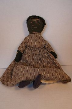Antique brown calico dress on early black cloth doll
