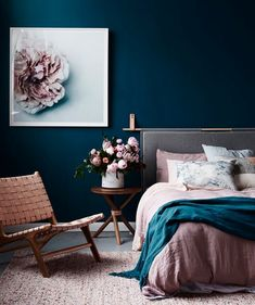 Shades like Pantone's Burnished Lilac + Hawthorne Rose pair flawlessly with navy blue walls.