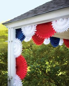 Tissue Paper Fan Decorations Suspended from the corners, these tissue paper fans are opened halfway and layered to make a breezy addition to a porch or a gazebo.