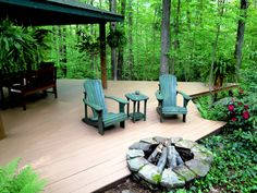 Peaceful patio in the forest ... interesting how they brought the fire pit closer to the home but still distant