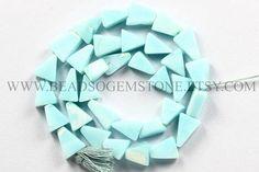 Blue Opal color enhanced Smooth Triangle Quality A 8x10 #peruvianblueopal #peruvianblueopalbeads #peruvianblueopalbead #peruvianblueopaltriangle #trianglebeads #beadswholesaler #semipreciousstone #gemstonebeads #beadsogemstone #beadwork #beadstore #bead