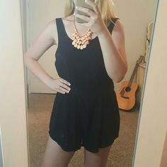 Hurley Scoop Back Black Romper Beautiful romper with a scoop in the back and small zipper detail. Fabric is super light and airy, great for warmer weather (100% rayon). Can fit small or medium. Only flaw is a small snag by the zipper shown in picture 4, but no stains or shrinking.  *No low ball offers please  *No trades  *Bundle for 10% off Hurley Pants Jumpsuits & Rompers