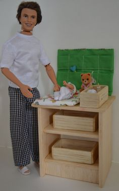 Changing table for doll nursery in 1/6 scale by FashionDollStore,   This gal, on Etsy, is just amazing at what she creates! Take a peek! I just ran across her shop this morning and couldn't resist sharing with fashion doll lovers...Deb