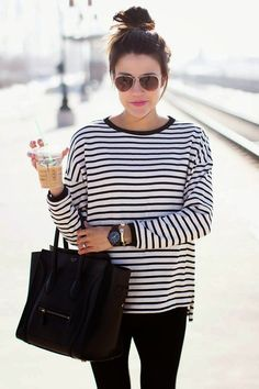striped top with black basics (skinny jeans and purse). Love the casualness of the sunglasses and messy top bun, too