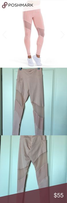 Dusty pink workout tights with mesh detail TLF Apparel workout tights are the best... and this color is so in right now! I wore these once for a photo shoot. In perfect condition. Pants Track Pants & Joggers