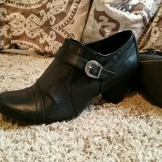 Black ankle boots with buckle Black. Lots of life left in them. Very comfortable Shoes Ankle Boots & Booties
