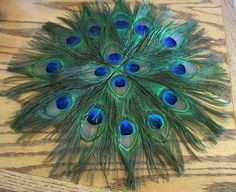 """16"""" Peacock Feather Placemat. $30.00, via Etsy."""