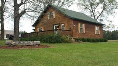 CEDAR LOG SIDING AND NEWER SHINGLE ROOF make the 1 ½ story home on this mini-farm the star attraction! Three bedrooms, two baths, new 2014 Kitchen with granite counter tops, hickory cabinets with slide out drawers, stainless steel appliances. Nice older-style barn has 3 horse stalls, a small loft for hay storage, plus additional stalls! The root cellar has a shop/storage building above it. There's also a MOBILE HOME HOOKUP. RE/MAX Host Realty, Inc. Call 800-934-2011