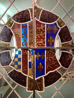 This was Anne Boleyn's coat of arms. This day right next to King Henry's coat of arms. Her coat of arms was symbolism for what she represented throughout her life and what she represented to the citizens of England itself.