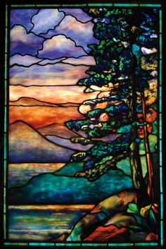 A large and impressive Tiffany leaded glass window using layers of mottled and confetti glass in a mountain forest lake scene more than doubled the low end of its $30,000-40,000 estimate to sell for $69,000