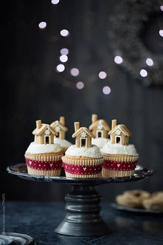 Gingerbread house cupcakes by Ruth Black for Stocksy United christmas cake Christmas Cupcakes, Christmas Sweets, Christmas Cooking, Noel Christmas, Christmas Goodies, Gingerbread Cupcakes, Gingerbread Houses, Winter Cupcakes, Christmas Ideas