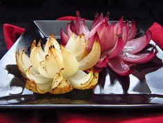 These flowers are made by simply slicing an onion into eighths, without cutting all the way through the onion so that it stays intact on the bottom, but the 'petals' fall down when baking to create a beautiful flower shape. The other ingredients are basic – just olive oil, balsamic vinegar, salt, and pepper – but the roasting gives the onions a really nice flavour, too!