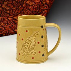 "The color I term ""camel"" returns time and again in Western designs, some might term it ""buckskin.""  I love the design of this pottery mug and colors are perfect!"