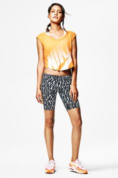 Ready to rock it. Sport a bold athletic style in the Nike Signal Cropped T-Shirt and LEG-A-SEE Shorts.